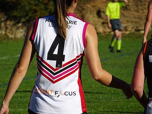 Talent Focus logo clearly visible on the shirt of an AFL player